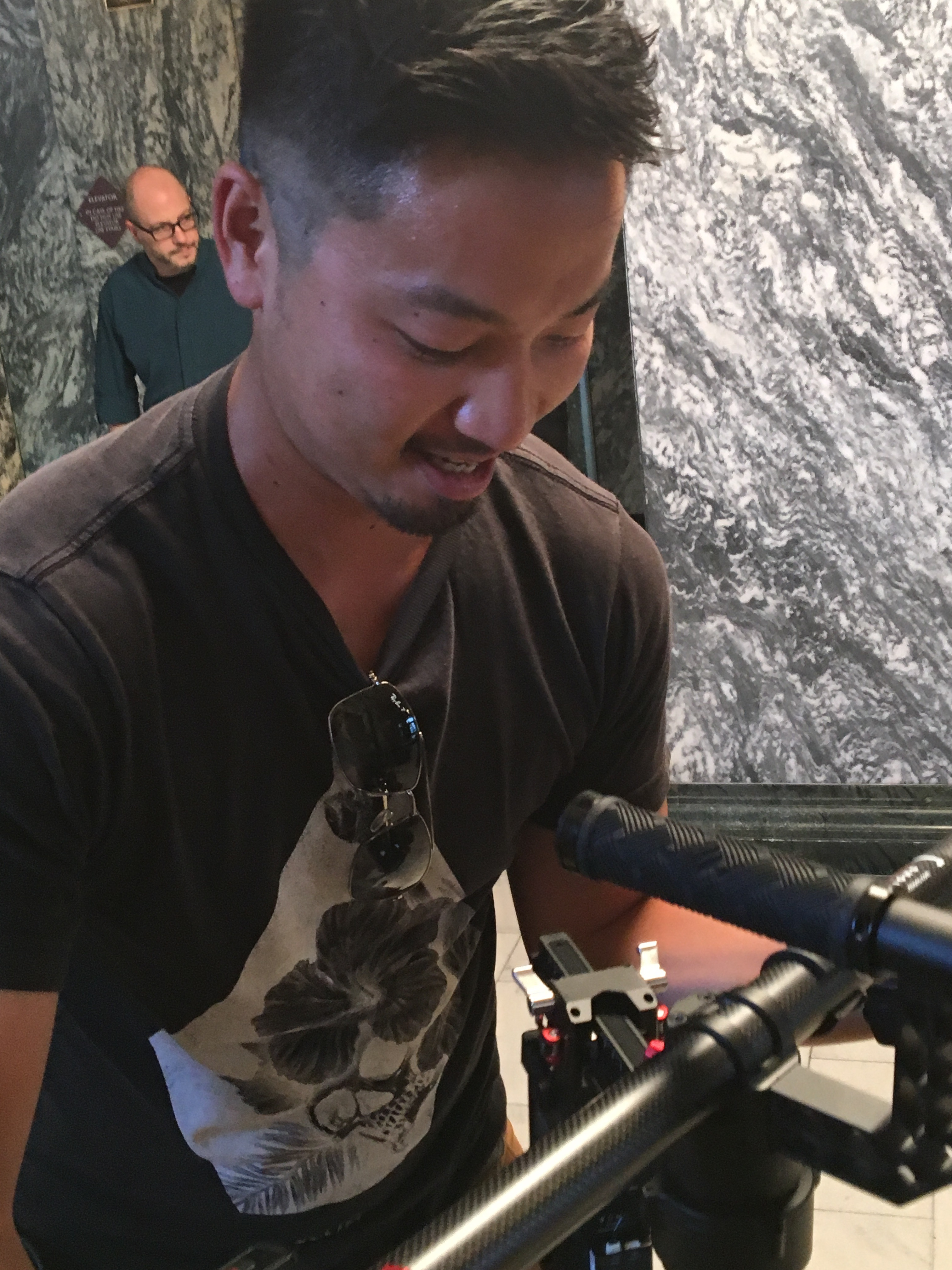 Shingo sets down his steady cam at the end of shooting a scene.
