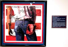 Signed album covers on exhibit through March 27