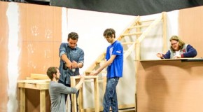 Film and video production majors build a set