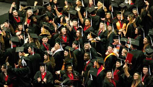 waving graduates