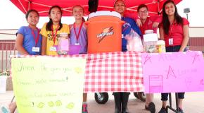 Jake McMahon/Pioneer Rachel Vu, 11, Faith Tran, 11, Alexandra Butler, 11, Esmeralda Garcia, 13, Madeline Angiel, 13, and Iliana Silva, 13, sell lemonade at Alex's Lemonade Stand near the entrance to OCCC's SEM center on July 9.