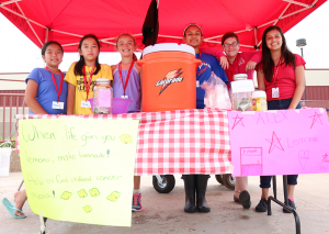 Jake McMahon/Pioneer Rachel Vu, 11, Faith Tran, 11, Alexandra Butler, 11, Esmeralda Garcia, 13, Madeline Angiel, 13, and Iliana Silva, 13, sell lemonade at Alex's Lemonade Stand near the entrance to OCCC's SEM center on July 9.