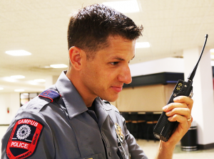 Jake McMahon/Pioneer Officer Patrick Martino shows one of the new radios received by the OCCC police department.
