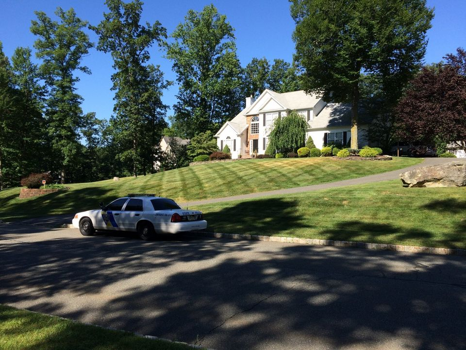 House and police car of off-duty state trooper