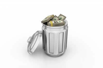 A picture of a large amount of money inside of a trashcan.