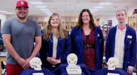The Biology Lab recently received donated anatomical skulls from The Health Professions Club. From left to right: Caleb Hill, Health Professions Club President; Melissa Henkel, Senior Biology Lab Assistant; and Biology Lab Assistants Audri Malik and William Layden. Melissa Sue Lopez/Pioneer.