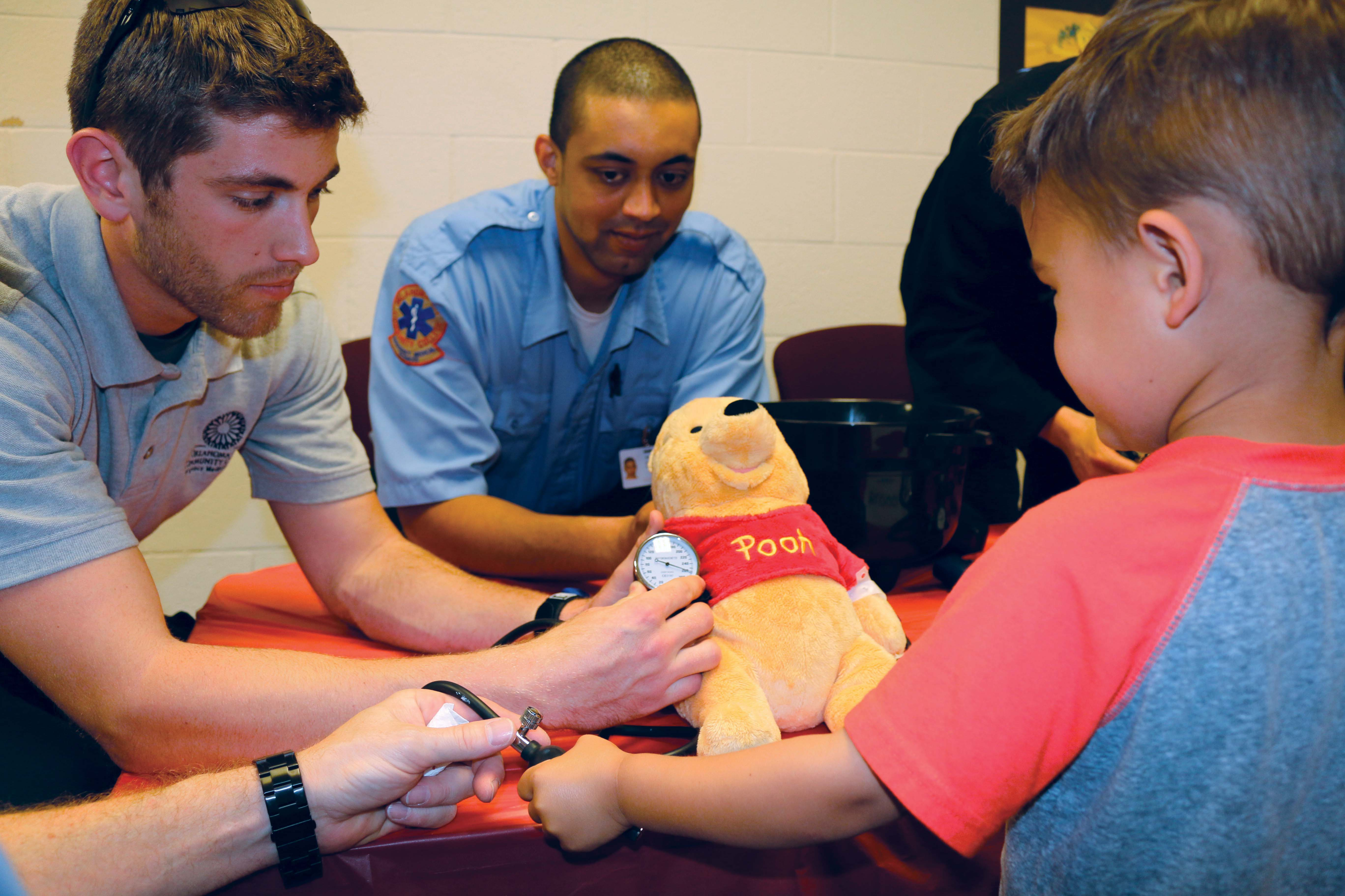 Kids learn teddy bear care from students