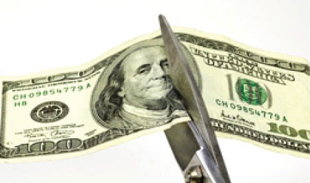 scissors cutting dollar
