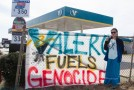 "Ashley McCray, co-founder of group, No Plains Pipeline, stands next to ""Valero Fuels Genocide"" sign outside of Valero on I-240 and May on Wednesday, February 1st. This is the 3rd reported demonstration outside of Valero gas stations around the city in the past 2 days. ""We will be doing this as long as necessary until we get the message across (about the Diamond Pipeline and Valero's involvement in it)"" said McCray.  Photos by Aaron Cardenas"