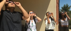 OCCC Students Jesse Hosein, Allison Hughes, Loveth Ehimenich, and Olivia Ibiam look towards the eclipse. Photo by Brandon King