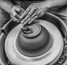 A pottery student trims the clay for a new pot. Leonardo Villaseca-Cruz