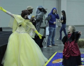Woman dressed as Belle teaches a young girl the Time Warp from Rocky Horror Picture Show. Photo by Sean Stanley