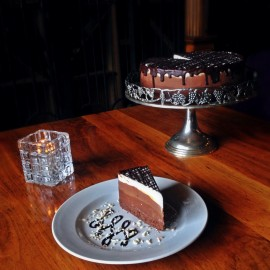 Another of Caleb Shepherd's desserts is the Black Cocoa Gluten Free Cake under dark chocolate mousse, milk chocolate mousse, and white chocolate mousse. Garnished with a dark chocolate drizzle. This can also be found at Benevuti's.