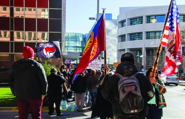 okc inauguration protest marchers flags