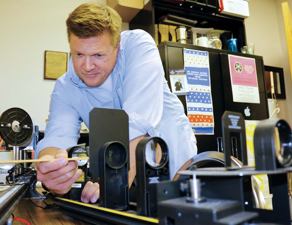 Physics Professor, Tad Thurston, uses a diffraction grating with a laser to split light into little pieces.
