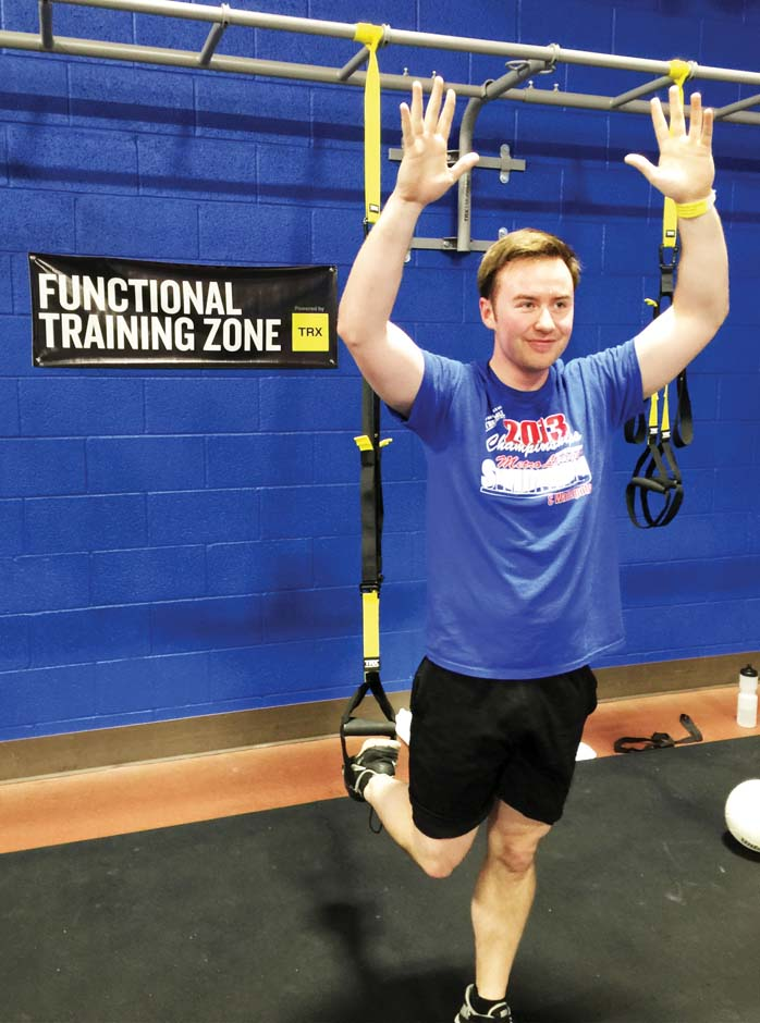 "Chris Hellwege, sociology major, taking the TRX (Total Body Resistance Exercise) class after his academic classes. ""I have noticed I have been doing better in homework and test  taking after this class,"" Hellwege said. For more information about the TRX or any of the other classes  available at the Wellness Center call 405-682-7860 or visit www.occc.edu/rf/index.html. Melissa Sue Lopez/Pioneer"