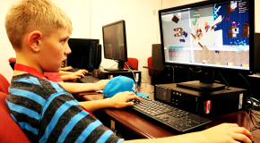 "Zach, 11, plays a video game called ""Roblox"" in the Humanoid Robotics camp on June 17. Jake McMahon/Pioneer"