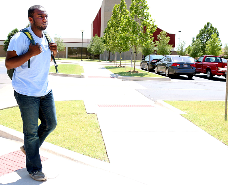 Chemical engineering major Michael Nwanebu walks to his car after class on June 30. Summer semester ends July 24. Jake McMahon/Pioneer