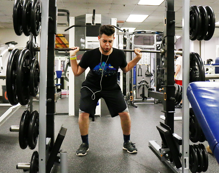 "Business and management major Javier Meraz lifts 145 pounds in OCCC's Wellness Center on June 16. ""I'm here to get big,"" Meraz said.     Jake Mcmahon/Pioneer"