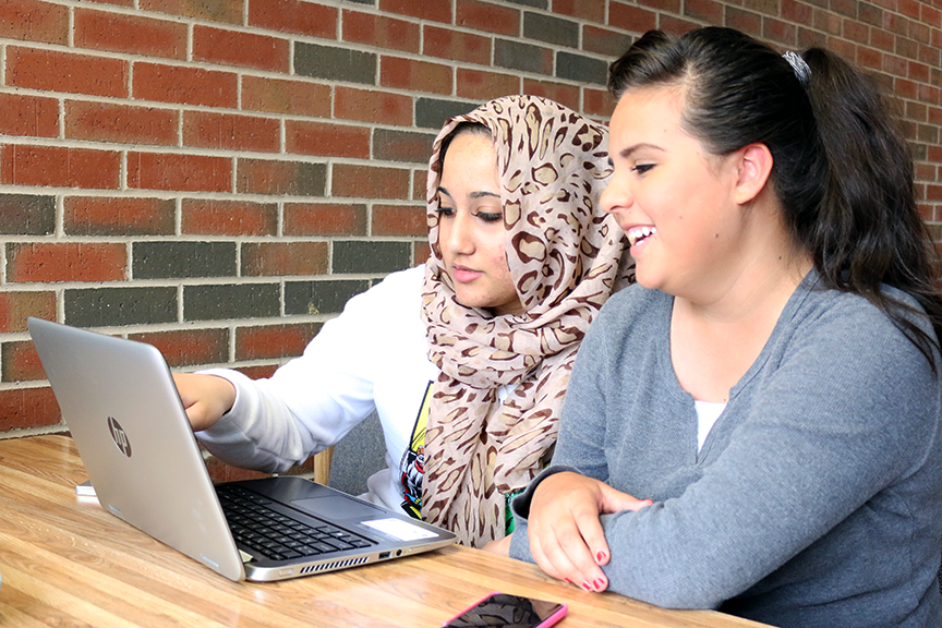 "Nursing major Fatema Abdul and psychology major Deisy Jaquez study in the Arts and Humanities building on June 16. ""I'm studying my math stuff, but we got sidetracked. We're studying sign language now,"" Abdul said.   Jake McMahon/Pioneer"