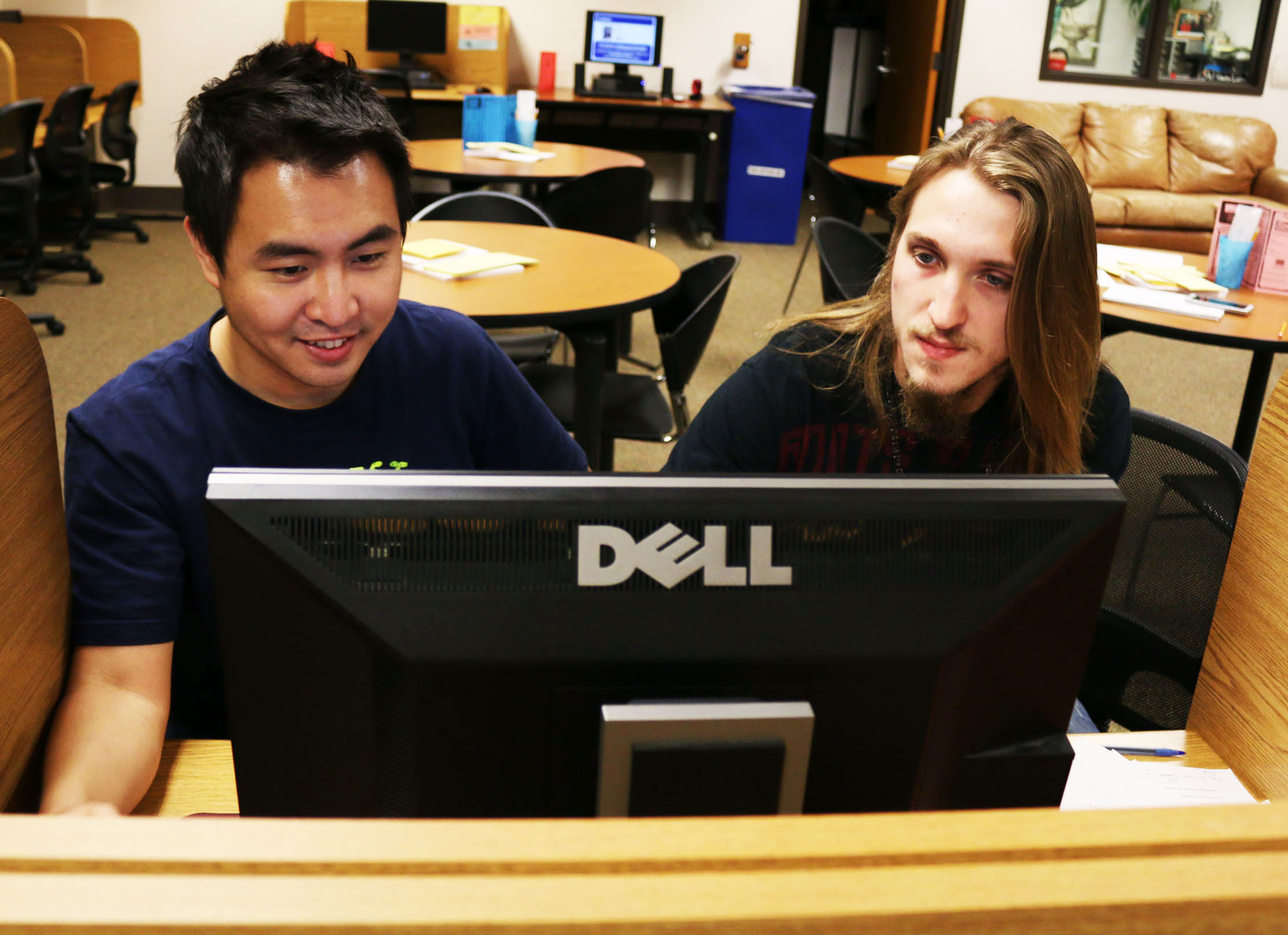 "Business major Jonghyeok Yang is tutored by engineering major Deven Thompson for his English Comp II class on July 1 in the Communications Lab. ""I'm helping him with citations,"" Thompson said. Jake McMahon/Pioneer"
