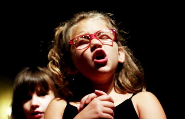 "Maece, 7, and Addie, 7, rehearse a song June 24 for the Musical Theater ""Yee Haw!"" class in the Bruce Owen Theater. See more photos and read about the class on page 6.    Jake McMahon/Pioneer"