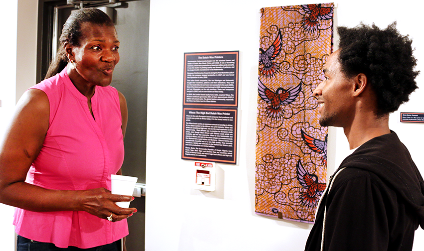 Gifty Benson explains African wax prints to a student