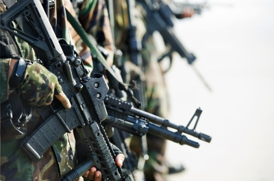 soldiers in a line holding guns