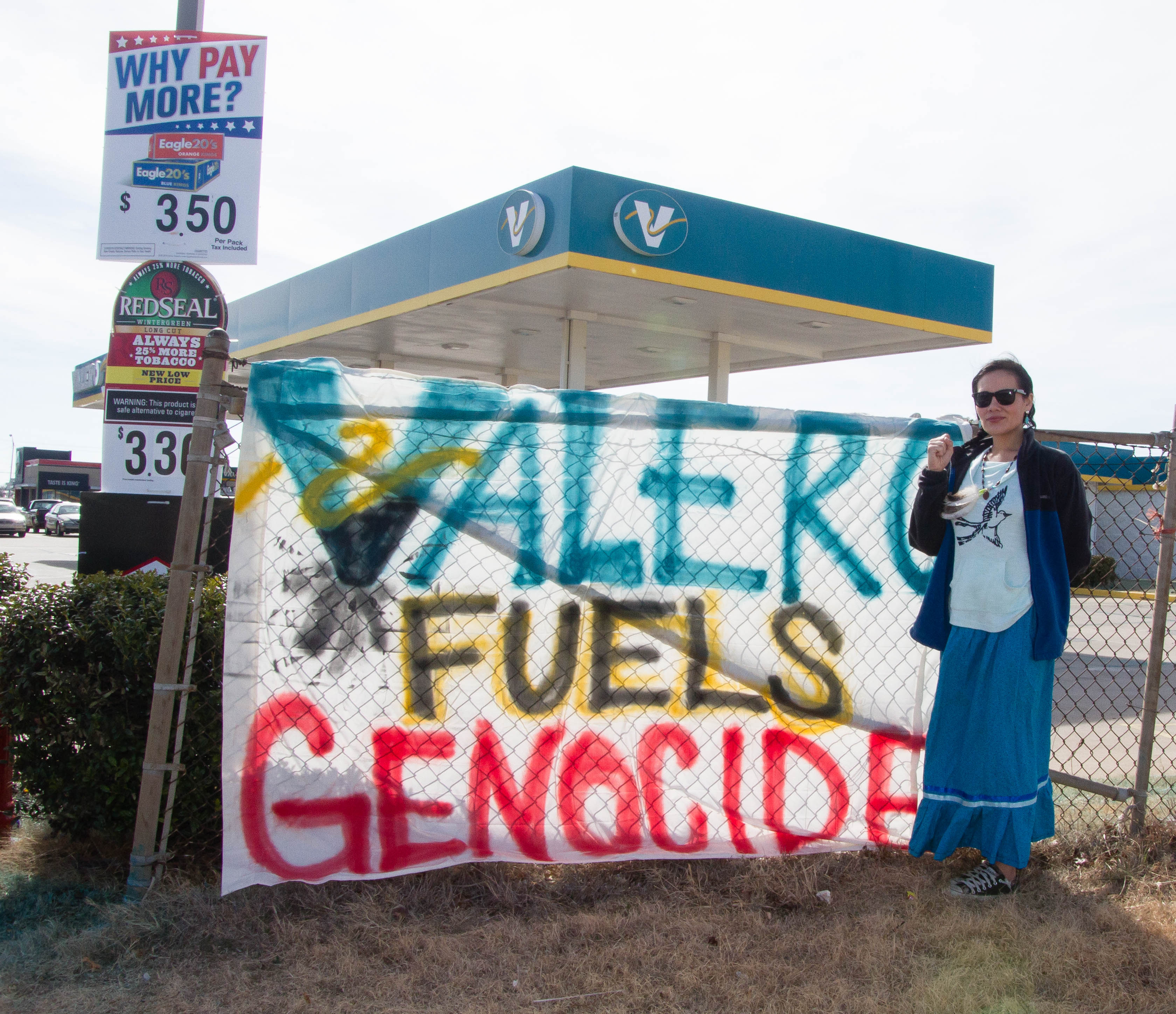 Demonstrators rally against Diamond Pipeline at gas station near campus