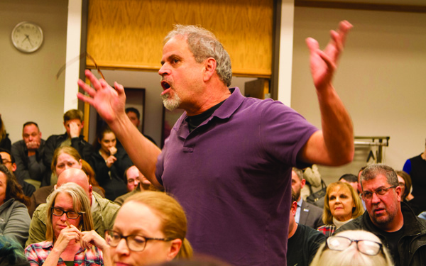 Town hall meeting gets heated