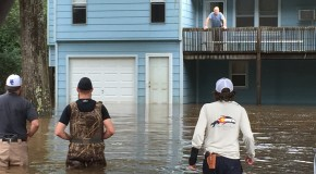 Tyler Smith (Right) and other volunteers help those stranded. Photo provided by Tyler Smith.