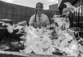 Paula Clay starting her fire starting technique. Photo by Leonardo Villaseca-Cruz