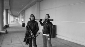 Two cosplayers dress as Daryl Dixon and Negan from The Walking Dead. Photo by Sean Stanley